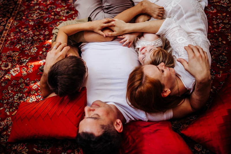 San Diego Family Photography, family of four laying on a red rug