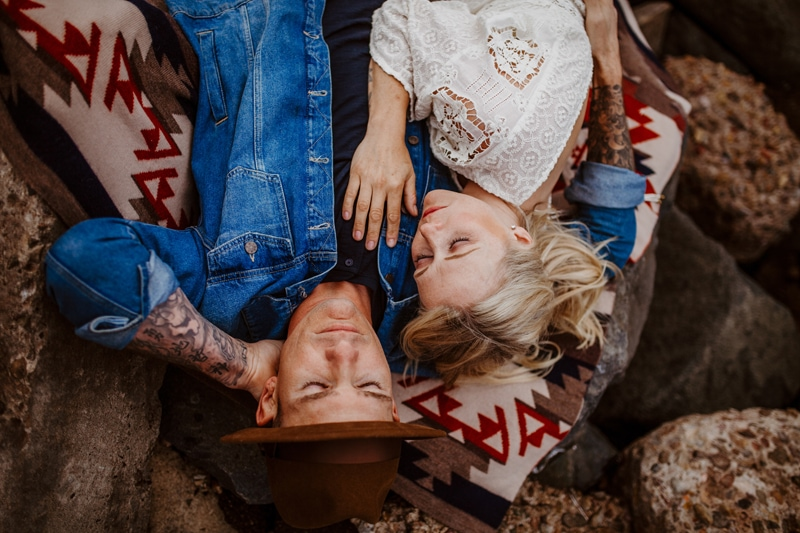 San Diego Couples Photography, laying in a rock with blanket