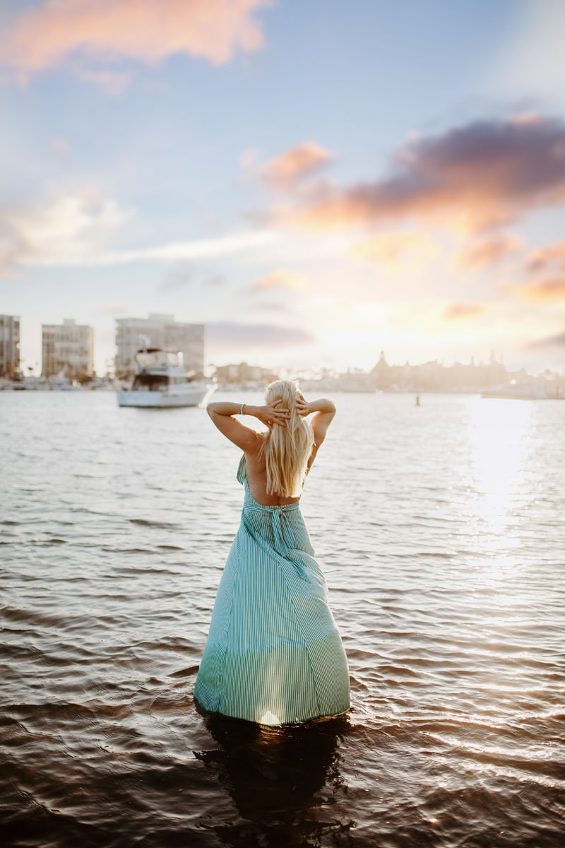 San Diego Branding Photography, woman in blue dress standing in water