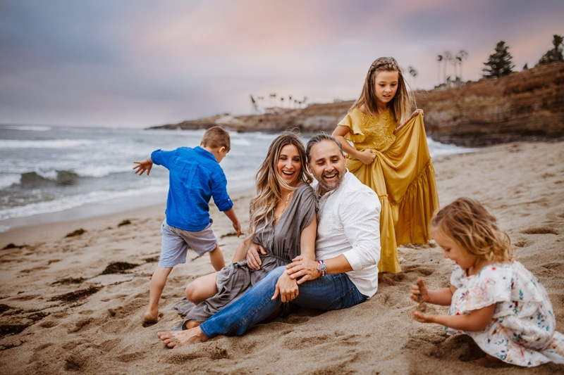 San Diego Family Photography, family of five laughing and playing together on the beach