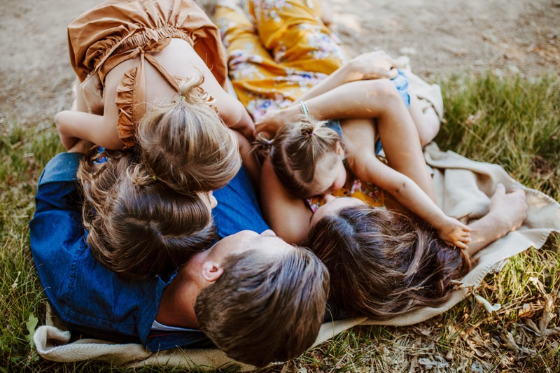 San Diego Family Photography, family of 5 cuddling on a blanket in the grass