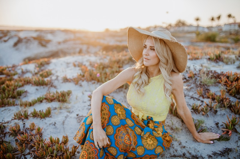 San Diego Branding Photography, woman in big hat sitting at the beach
