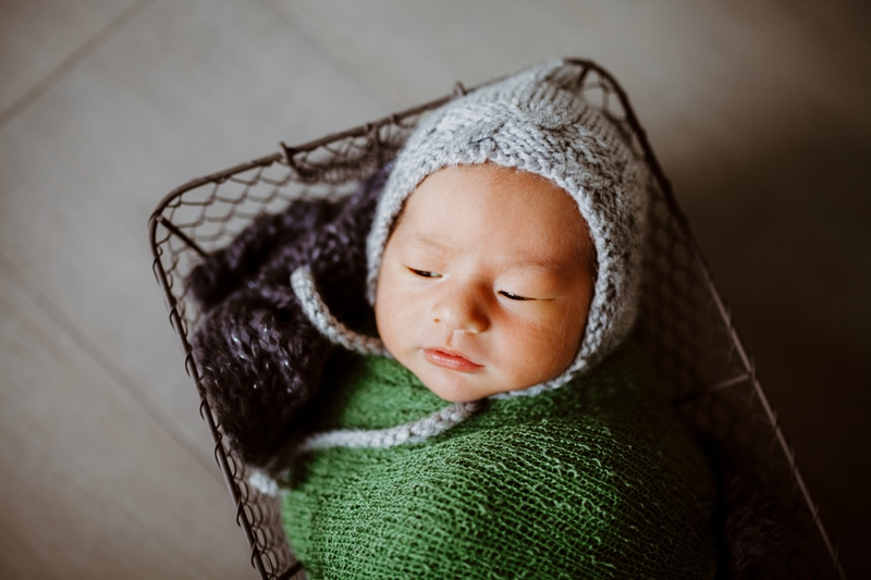 San Diego Newborn Photography, newborn baby in basket with bonnet