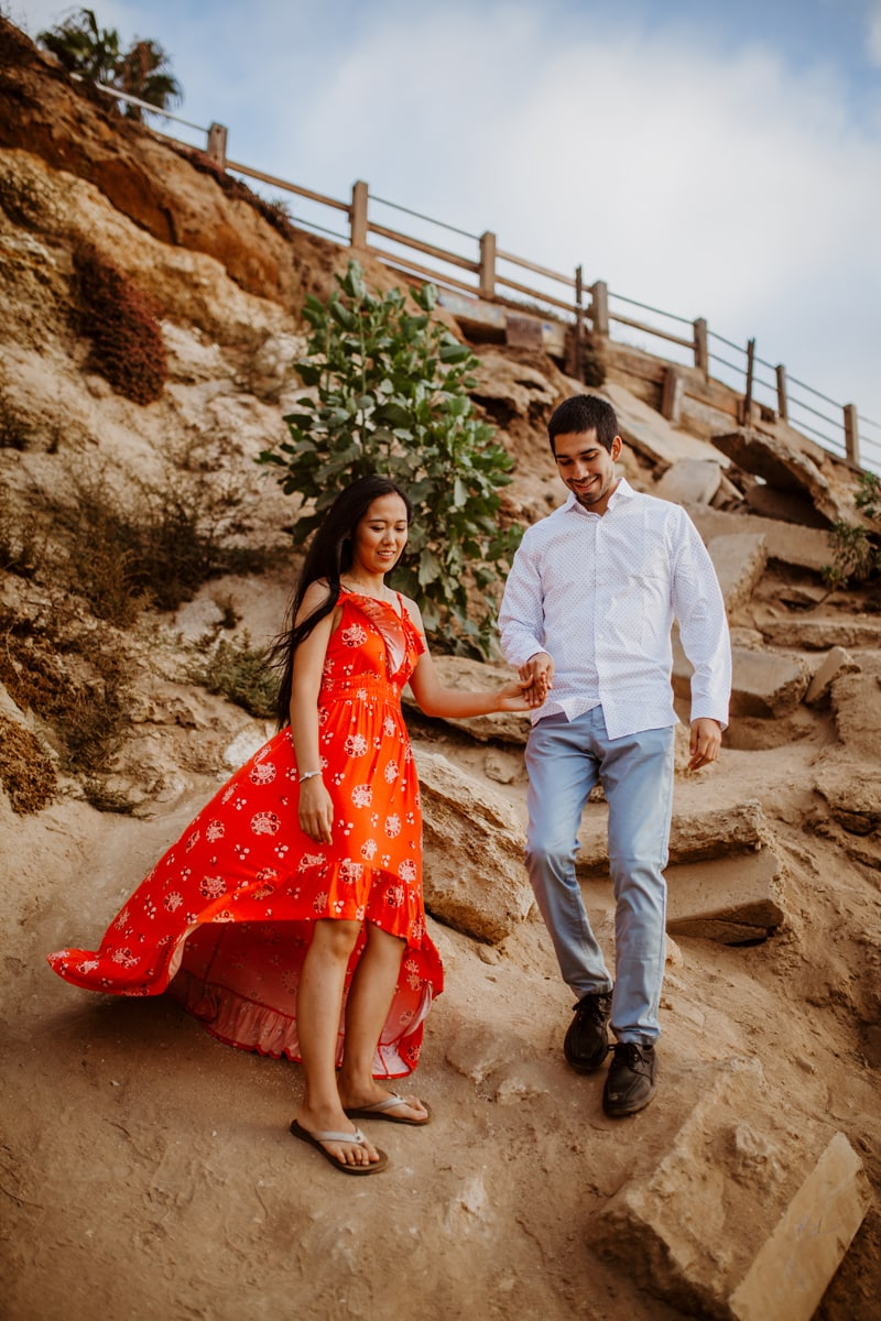 San Diego Couples Photography, couple walking down a cliff side together