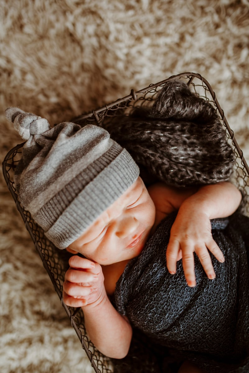 San Diego Newborn Photography, baby sleeping in basket with gray beanie