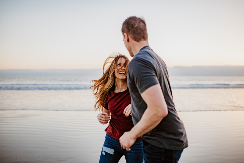 San Diego Couples Photography, couple running along the beach, laughing together