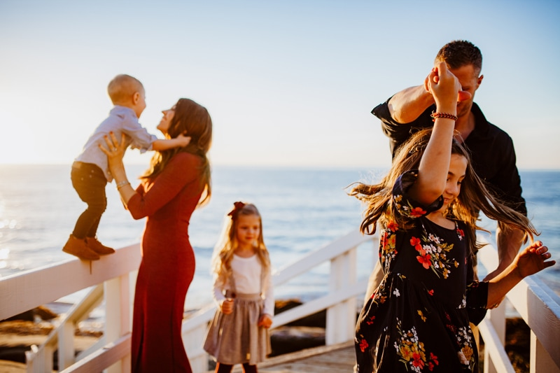 San Diego Family Photography, family of 5 walking up the stairs next to the beach