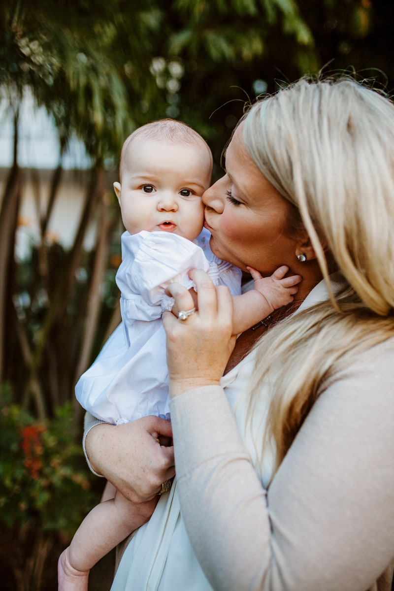 San Diego Newborn Photography, mother kissing baby on the cheek