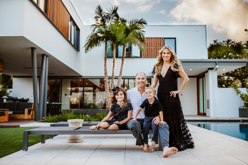 San Diego Family Photography, family of four in front of modern looking house