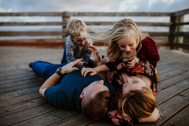 San Diego Family Photography, family of four laying down on a pier