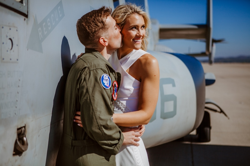 San Diego Military Homecoming, young pilot kissing woman's cheek