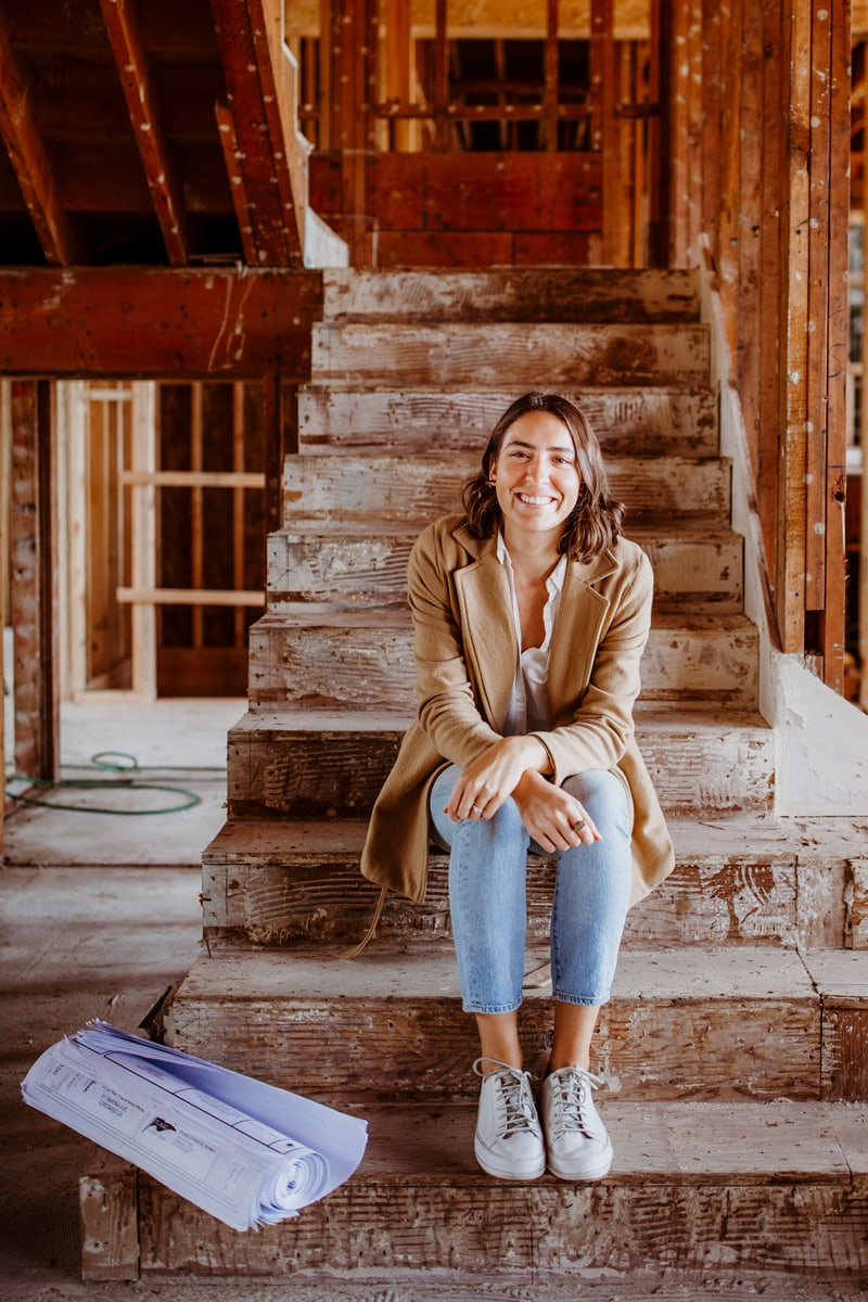 San Diego Branding Photography, woman sitting on the stair in an unfinished home