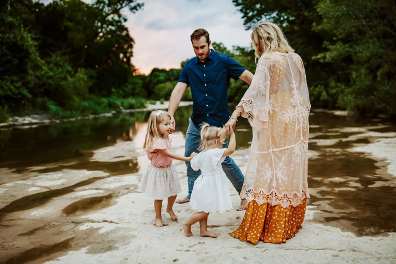 San Diego Family Photography, family of four holding hands together on the river bank