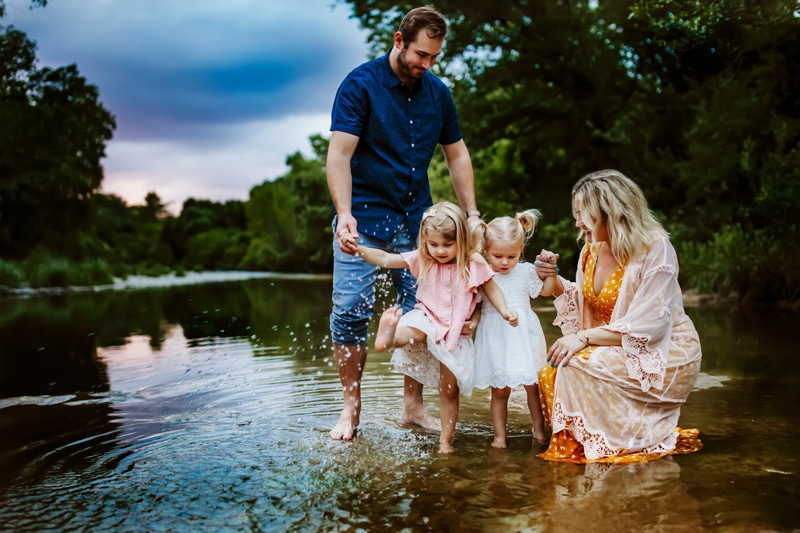 San Diego Family Photography, family of 4 in the river with little girls splashing with their feet