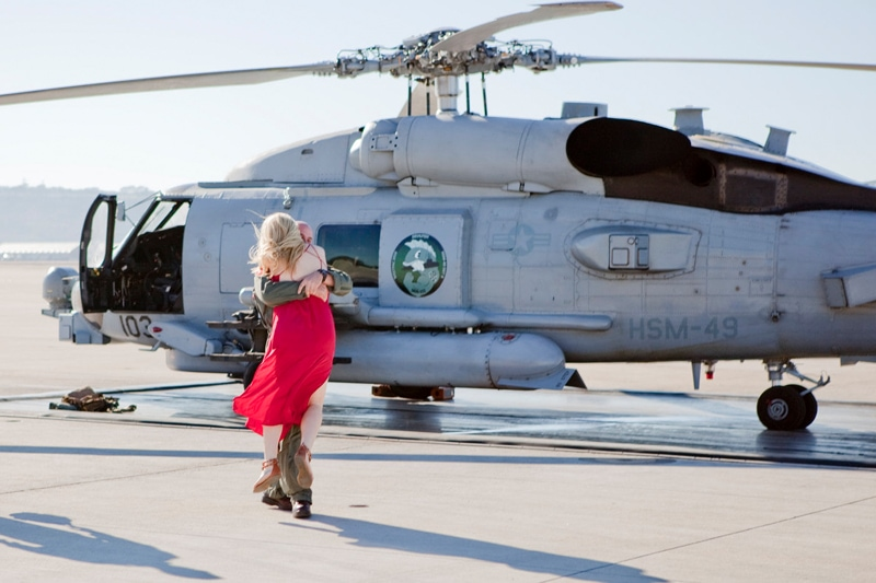 San Diego Military Homecoming, helicopter pilot with woman in red