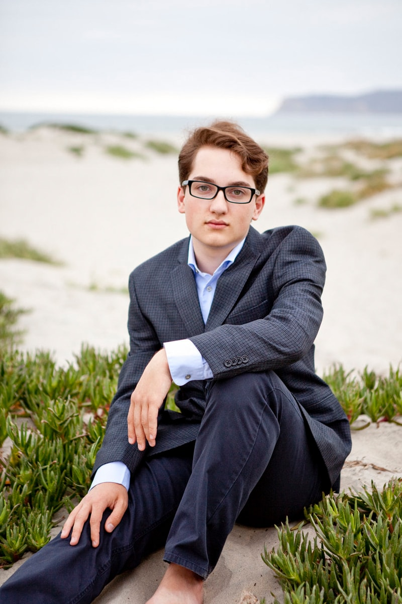 San Diego Senior Photography, boy in suit by the water