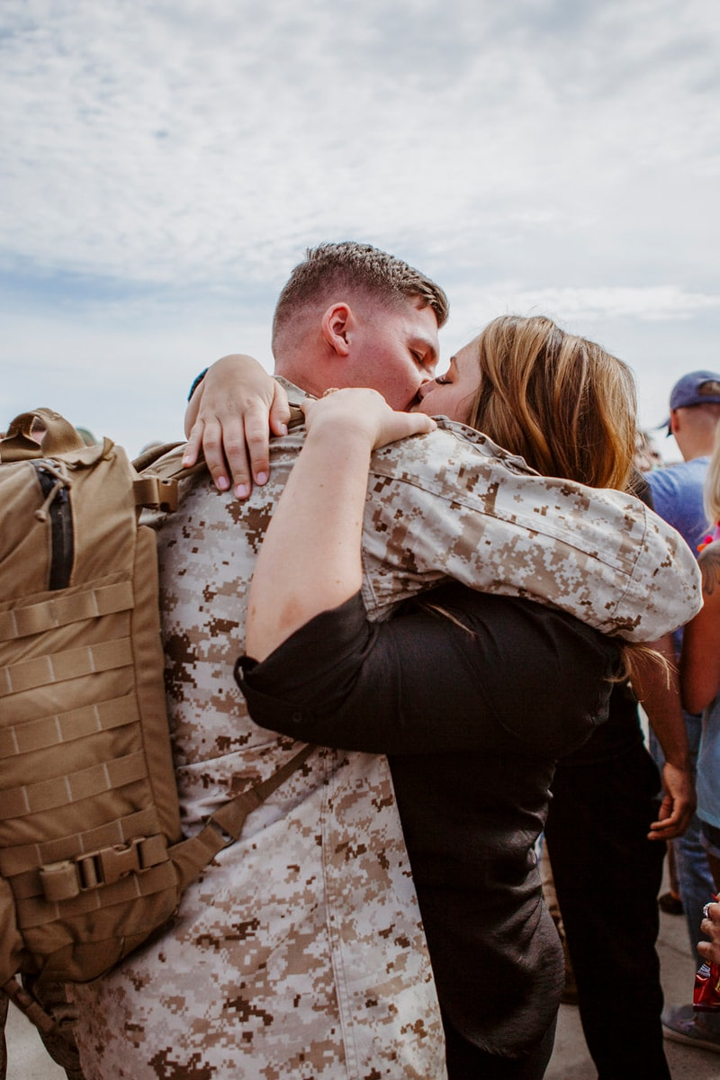 San Diego Military Homecoming, couple hugging and kissing