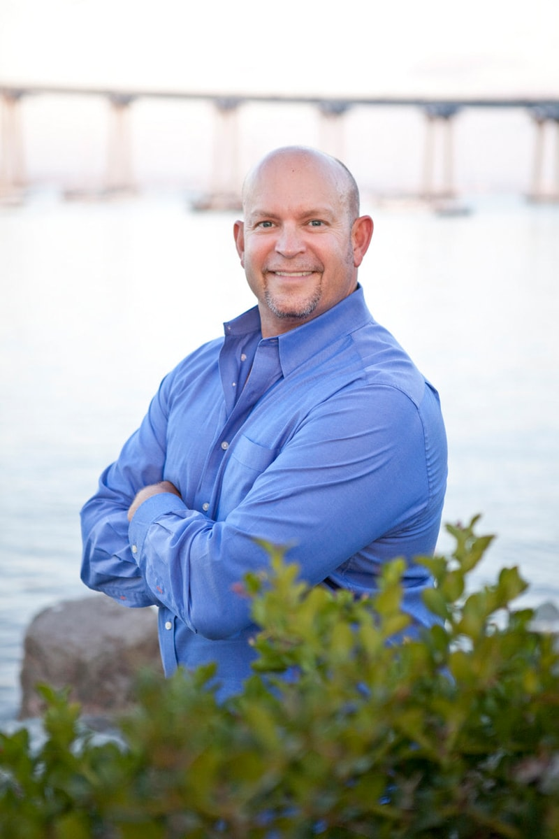 San Diego Branding Photography, man in blue button up top next to the water