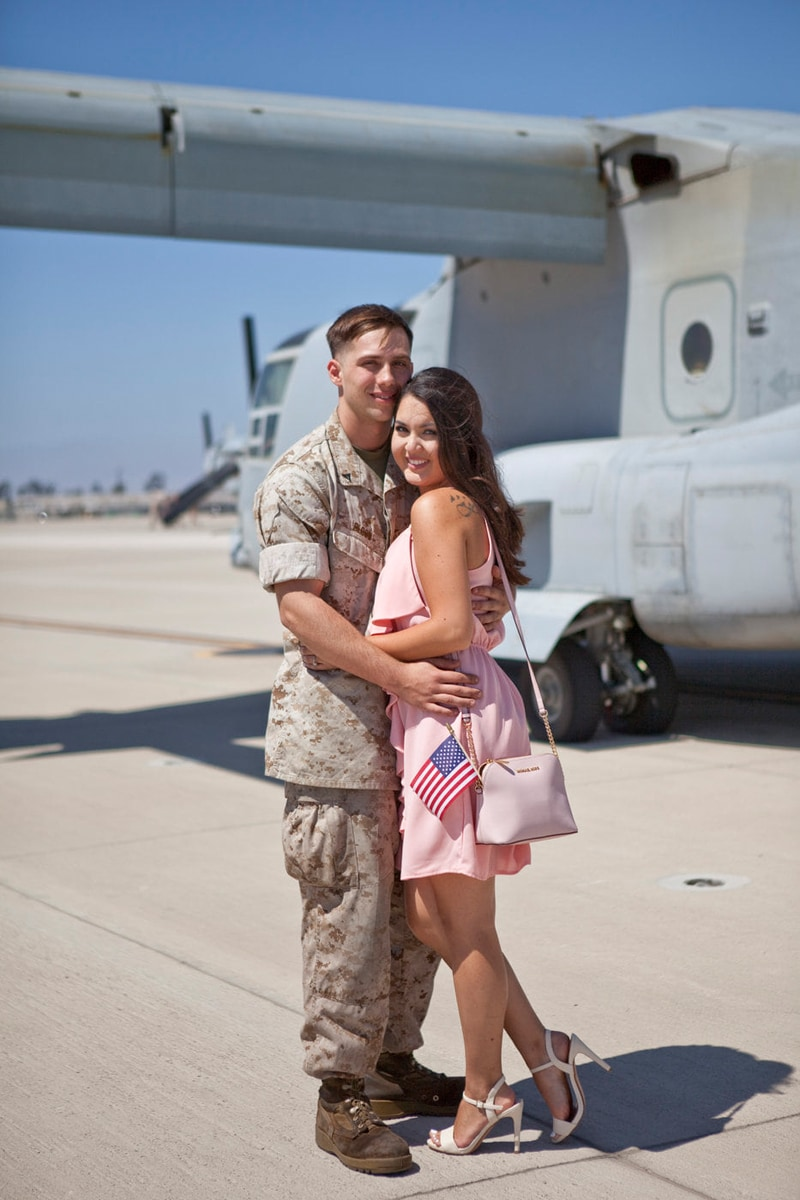 San Diego Military Homecoming, couple standing next to a plane