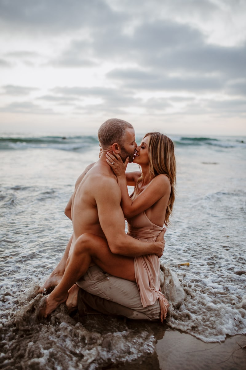 San Diego Couples Photography, couple sitting in the water and kissing