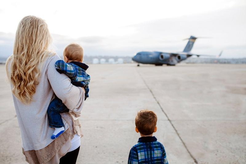 San Diego Military Homecoming, mother and two boys watching an incoming plane