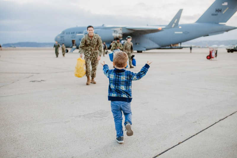 San Diego Military Homecoming, little boy running to his dad