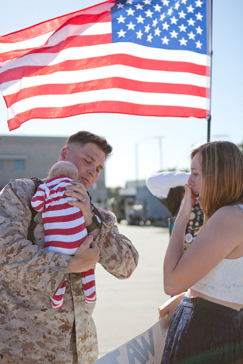 San Diego Military Homecoming, new dad getting to hold his baby for the first time